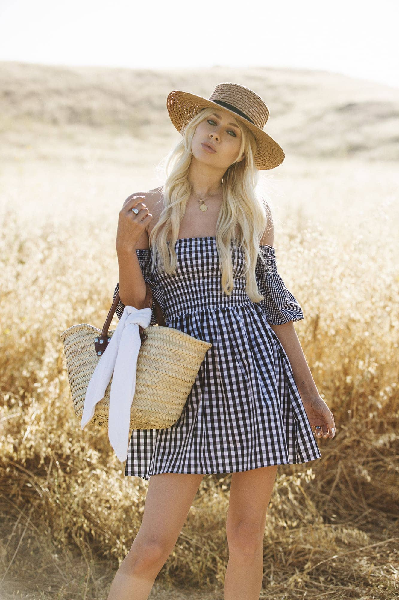 Sarah Loven wears The Vetiver Collection gingham dress